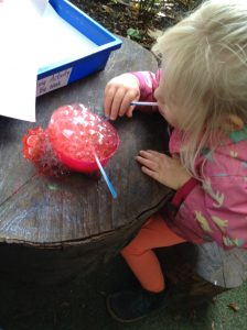 blowing paint bubbles to create art